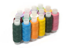 Spools with different color sewing threads Stock Photography