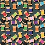 Spools of thread on dark background. Spools of different colors thread on dark background seamless illustration Stock Images