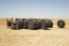 Spools Of Irrigation Hose On Arid Landscape Stock Image