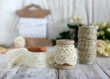 Spools with lace trim and baker`s twine. Laces and trims. Crafting and sewing supplies Stock Photos