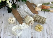 Spools with lace trim and baker`s twine. Laces and trims. Crafting and sewing supplies. Hobby royalty free stock images