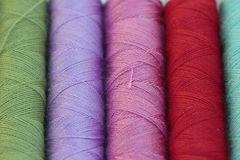 Spools of many colors of thread Royalty Free Stock Images