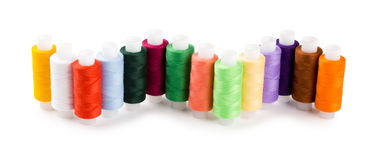 Spools multi-colored threads located a wave Royalty Free Stock Photos