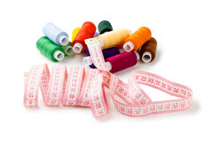 Spools Multi-colored threads with a measuring tape Stock Images