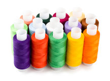 Spools multi-colored threads standing group Stock Photos