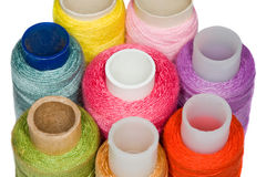 Spools with multi-coloured sewing threads isolated Stock Photo