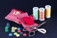Spools, Neddle Case, Scissors, Buttons and Thimbles Royalty Free Stock Photography