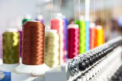 Spools of new threads closeup, sewing machine Royalty Free Stock Photo