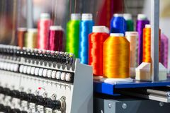 Free Spools Of Color Threads Closeup, Spinning Machine Stock Photos - 100551173