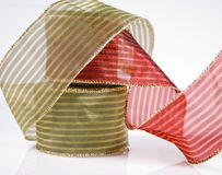 Spools Of Decorative Red And Green Ribbon Royalty Free Stock Photography