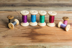 Free Spools Of Thread On Wooden Background. Old Sewing Accessories. Royalty Free Stock Image - 54410756