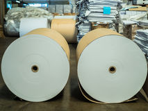 Spools of paper. Spools of paper in Book factory stock illustration