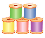 Spools of Pastel Thread. Spools of thread in pastel green, blue, yellow, pink and purple for sewing, tailoring, quilting, crafts, needlework & do it yourself Stock Image
