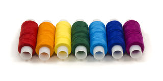 Spools of rainbow colored threads Royalty Free Stock Photography