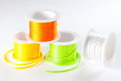 Spools of ribbon on white background Royalty Free Stock Photography