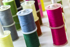 Spools of sewing thread of different colors Stock Image