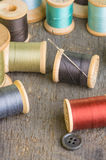 Spools of sewing thread with needle royalty free stock photos