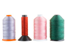 Spools of silk thread in a row Royalty Free Stock Photography