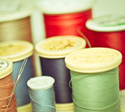 Spools of thread. Reels of Thread of several colors. Vintage looking Royalty Free Stock Images