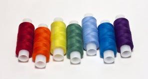 Spools of thread. Rainbow colored spools of thread stock image