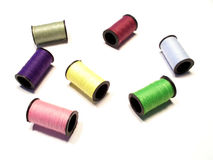 Spools of thread. Isolated colorful sewing spools.  Most of the view in focus Royalty Free Stock Photos
