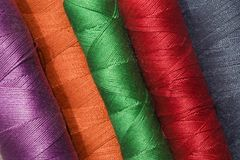 Spools Of Thread. Macro view of colorful spools of thread Royalty Free Stock Photo