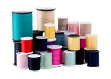 Spools of Thread. Stack of spools of clothing thread in many colors royalty free stock photo