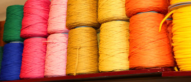 spools of thread and balls of wool for sale in the shop for tail Stock Image