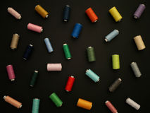 Spools of thread on a black background. Stock Photography