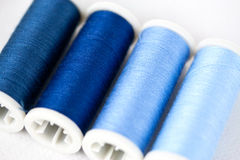 Spools of thread blue Stock Images