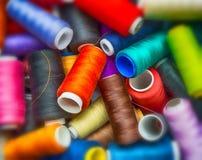 Spools of thread, blur on the edge Royalty Free Stock Photos