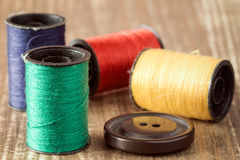 Spools of thread and button Royalty Free Stock Image