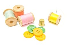 Spools of thread with buttons Royalty Free Stock Images
