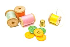 Spools of thread with buttons on white Stock Image