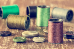 Spools of thread and buttons Stock Image