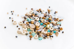Spools of thread, colorful beads and sewing buttons Royalty Free Stock Images