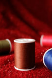 Spools of Thread on Fabric Stock Photo