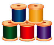 Spools of Thread in Jewel Tones. Spools of thread in jewel colors for sewing, tailoring, quilting, crafts, needlework & do it yourself projects. EPS8 organized Stock Photos