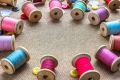 Spools of thread laid out in a circle Stock Photo