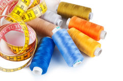 Spools of thread and measuring tape Stock Photos