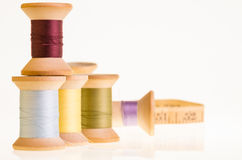 Spools of thread and a measuring tape Stock Photos