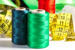 Spools of thread and measuring tape Royalty Free Stock Photography