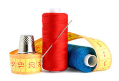 Spools of thread, measuring tape and thimble Stock Photography