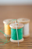 Spools of Thread and Needle Stock Photography