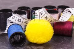 Spools of thread, needle and centimeter. Accessories for embroidery and sewing. Spools of colorful thread, needle and centimeter. Accessories for sewing royalty free stock photos