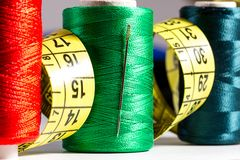 Spools of thread, needle, measuring tape, button Royalty Free Stock Image