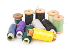 Spools of thread with needle Stock Images