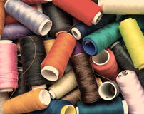 Spools of thread. old photos. Colorful spools of thread closeup. photo in old style image Royalty Free Stock Photo