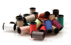 Spools of Thread Pile. Variety of colors of spools of thread Stock Photos