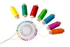 Spools of thread and pins on white background. Selective focus Stock Images